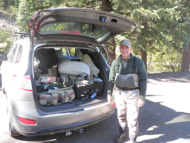 Jeff Next to Our Jam Packed Travel Vehicle