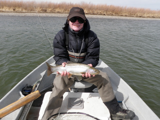 Dave Displays His Nicest Catch of the Day, an Eighteen Inch Rainbow